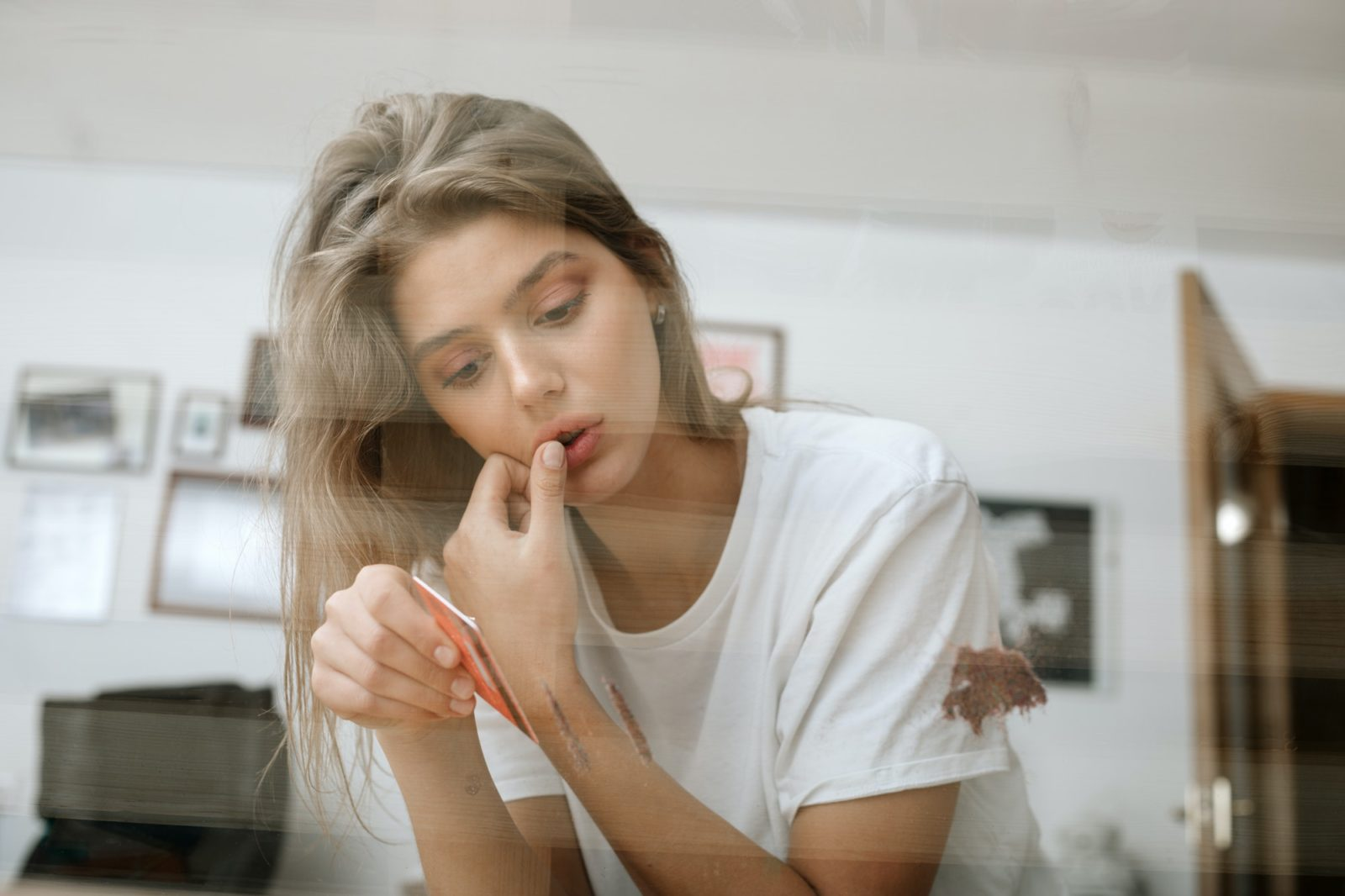 young woman making lines for sniffing glitter, confetti (imitation)